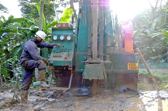image of borehole drilling with little boy