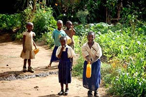 Small-girls-carrying-water